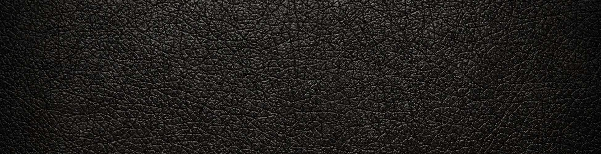 cropped-cropped-cropped-leather-black-cracked-background-texture1.jpg