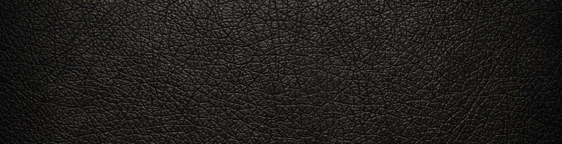 cropped-cropped-leather-black-cracked-background-texture1